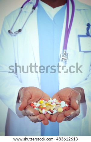 African Doctor hands holding pills