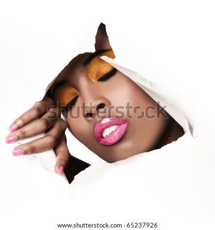 African woman with pink and yellow metallic make-up and full shiny lips - on the paper whole background