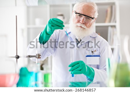 Aged biochemist working in laboratory