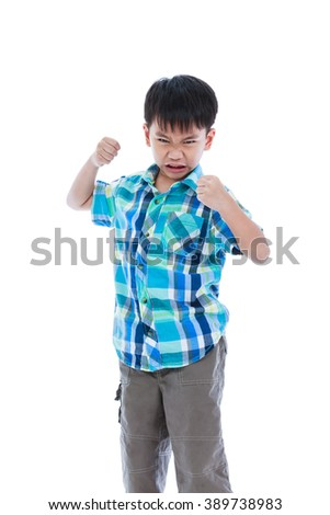Aggressive asian child. Boy looking furious. Isolated on white background. Negative human face expressions, emotions, reaction, conflict, confrontation. Concept about aggressive behavior in childhood.