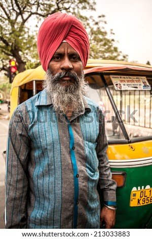 AGRA, INDIA - APRIL 12: Unidentified man who dress indian tradition cloth hat and drive  public car transportation that's call 'auto rickshaw' on Apr 12, 2014 in Agra, India.