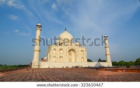 AGRA, INDIA - JULY 19, 2015. View of Taj Mahal in sunny day. It is one of the most recognizable structures in the world and the biggest tourist highlights in Uttar Pradesh, India.