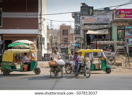AGRA, INDIA - SEPTEMBER 01, 2016 : Cars, motorcycles, cycle, and other traffic on road in India