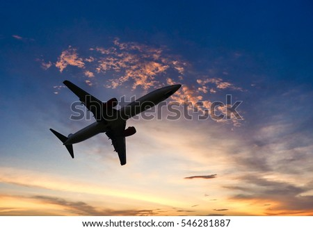 Air plane silhouette over the sunset cloud