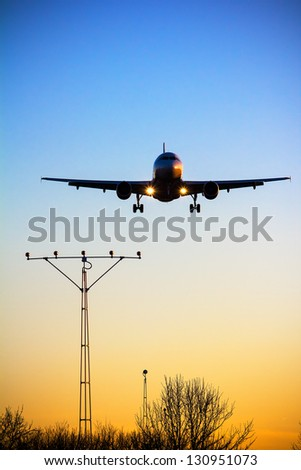 Aircraft is landing at sunset