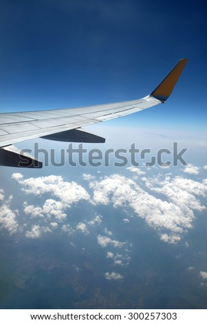 Aircraft wing on the blue sky background