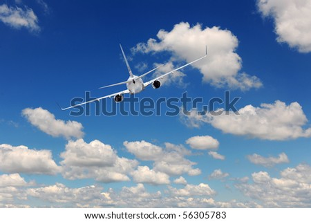 Airliner flying over blue sky with clouds
