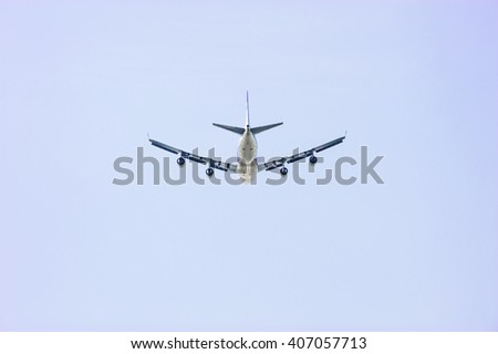 Airplane flying in the blue sky and white clouds.