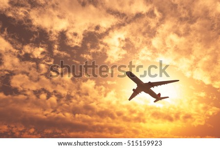 Airplane flying on the sky sunset