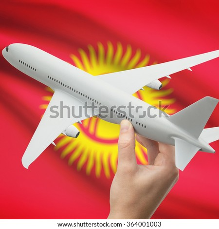 Airplane in hand with national flag on background series - Kyrgyzstan
