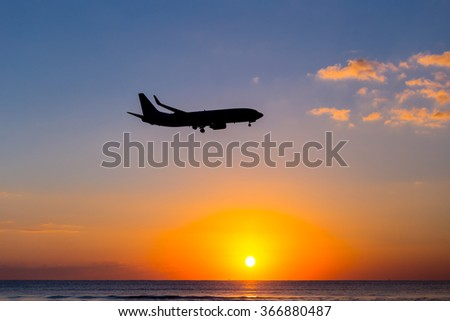airplane silhouette on a sunset background