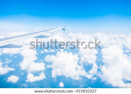 Airplane wing on beautiful blue sky with cloud background - Boost up color Processing
