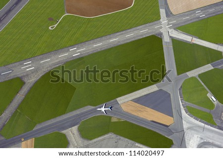 Airport - aerial view with runways, taxis, grass and air-crafts