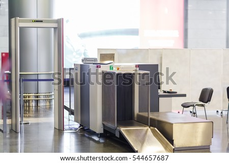 Airport security check point with metal detector and X ray scaner