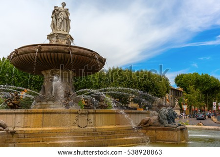 Aix-en-Provence - July 27, 2016: fountain on the Place de la Rontonde in Aix-en-Provence with unidentified people. Aix-en-Provence is University city and the historical capital of the Provence.