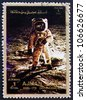 AJMAN - CIRCA 1973: a stamp printed in the Ajman shows Edwin Buzz Aldrin Walks on the Surface of the Moon, Moon-landing, Apollo 11, circa 1973 - stock photo