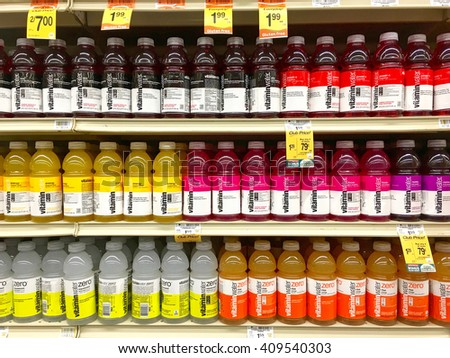 Alameda, CA - April 17, 2016: Grocery store shelf with Glaceau Vitamin Water in various flavors. is a privately owned subsidiary of The Coca-Cola Company.