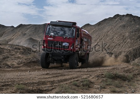 ALASHAN, CHINA-JULY 21, 2016: Sports truck gets over the difficult part of the route during the Silk Way rally Moscow-Beijing Dakar series on a dirt road