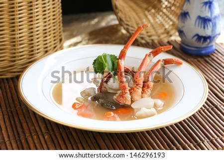 Alaskan king crab clear consomme soup in fine dining style