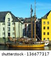 ALESUND, NORWAY: Hotels and yachts in the center of town Alesund in Norwegian fjords. Alesund is a sea port, and is noted for concentration of Art Nouveau architecture. - stock photo