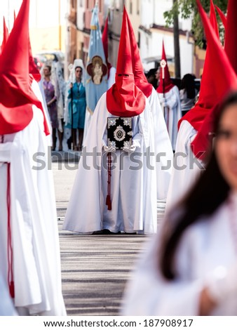 ALGECIRAS, SPAIN - APRIL, 13, 2014 : Procession on Holy Sunday of the easter week in Algeciras. A member of the brotherhood of penitents showing the emblem of the brotherhood.