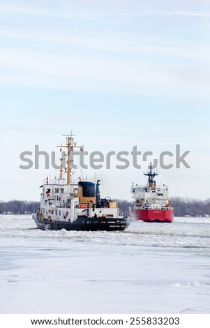 ALGONAC, MI - USA -JANUARY 25, 2015: The USCG BRISTOL BAY at Algonac, MI on January 25, 2015 working heavy ice in the North Channel of the St Clair River. The USCG MACKINAW is in the background.
