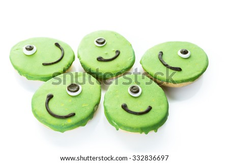 Alien cookies with green icing prepared as Halloween treats.