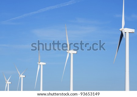 aligned group of windmills for electric power production