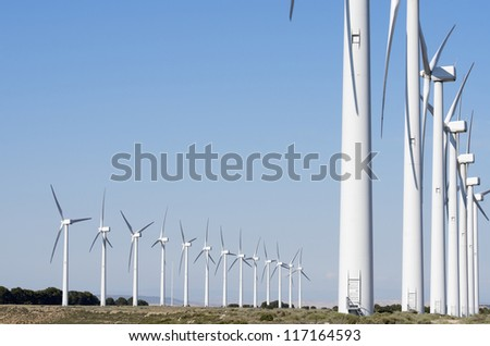aligned group of windmills for renewable electric energy production, Cintruenigo, Navarre, Spain