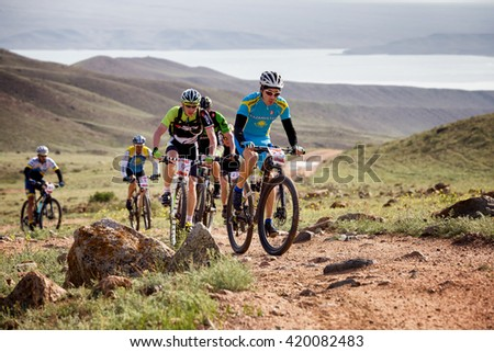 "ALMATY, KAZAKHSTAN - MAY 01, 2016: G.Torgautov (N23) in action at Adventure mountain bike cross-country competition in mountains ""Jeyran Trophy 2016"""