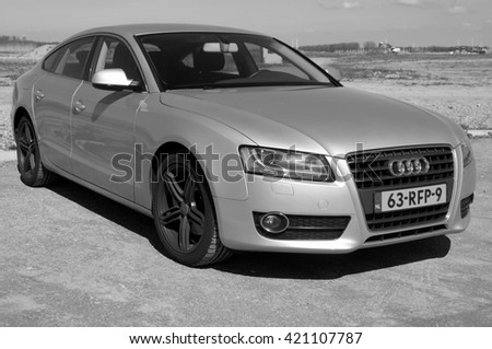 Almere, The Netherlands - May 1, 2016: Gray Audi A5 parked on a public parking lot in the city of Almere.