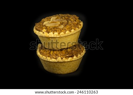 almond cup cake on black background