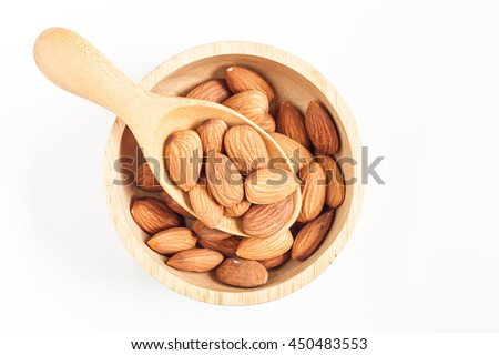 almonds, almonds in a wooden spoon and bowl on white  background, top view