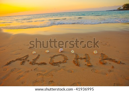 aloha written in the sand on the hawaiian beach