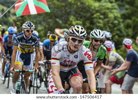 ALPE D'HUEZ, FRANCE, JUL 18: Andre Greipel from Lotto Belisol Team climbing the difficult road to Alpe-D'Huez, during the stage 18 of the edition 100 of Le Tour de France on July 18 2013.