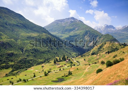 Alpine valley with golf fields. Summertime in Switzerland