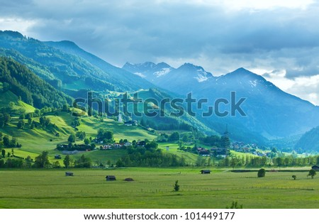 Alps mountains summer view and village in valley (Austria)