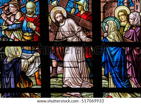 ALSEMBERG, BELGIUM - APRIL 3, 2008: Stained Glass window depicting Jesus meeting Mary and Veronica on the Via Dolorosa in the Church of Alsemberg, Belgium.