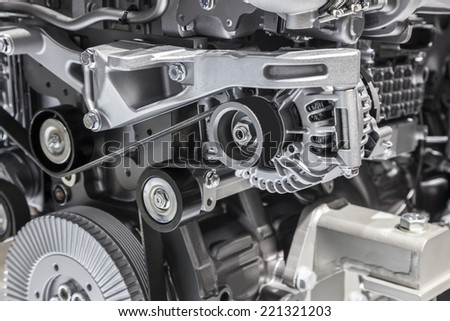 Alternator with flat drive belt at modern truck engine