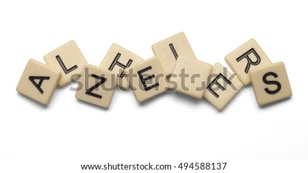 Alzheimers spelled out with lettered tiles on white background. Concept of aging. Clipping path included.