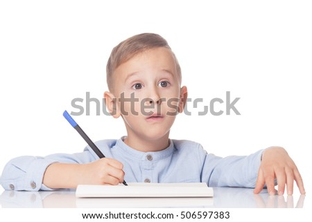 Amazed and thoughtful handsome boy with pen on isolated white