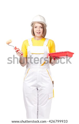 amazed female painter or decorator with paint roller and tray isolated on white background
