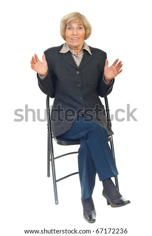 Amazed senior executive woman sitting on chair isolated on white background