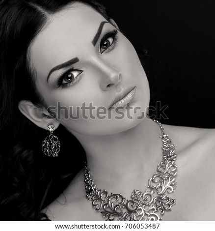 https://thumb10.shutterstock.com/display_pic_with_logo/1345723/706053487/stock-photo-amazing-portrait-eastern-woman-face-has-big-fairy-eyes-beautiful-brunette-hair-sexy-lips-long-706053487.jpg