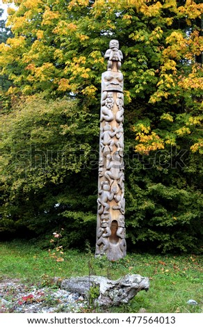 Amazing Totem poles with beautiful Autumn leaves on background in Stanley Park 4.  Photo Taken 2012.10.23 at Stanley Park,Vancouver Canada