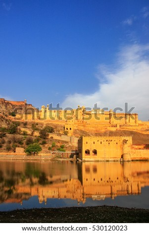 Amber Fort reflected in Maota Lake near Jaipur, Rajasthan, India. Amber Fort is the main tourist attraction in the Jaipur area.