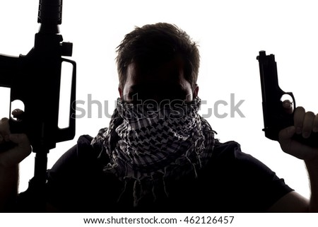 Ambiguous silhouette of a terrorist or a soldier with a rifle and a handgun.  The image depicts home grown terrorist or an anonymous special operations agent.