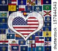 America flag,Flags of the U.S. states. background wood in the shape of heart - stock