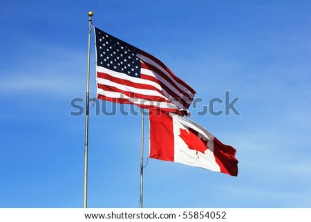 American and Canadian flags flying side by side at the International Flag Plaza in Port Huron, MI