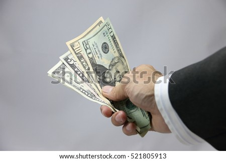 American dollars in hand,one dollar,five dollar,ten dollar,twenty dollar,on white background,Business and Financial concept